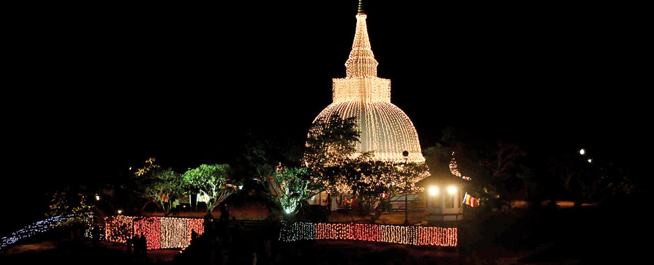Historic Thanthirimale decked in light for Poson