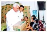 Pragna Pradeepa distributes schoolbooks to flood-affected children