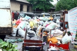 More muscle to shovel garbage, minister pleads for public help