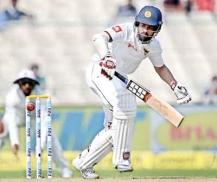 Thirimanne and Mathews  stir hope for Sri Lanka