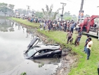 BMW said to be driven by Minister's son hits two cars before plunging into canal