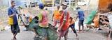Garbage separation exposes sanitation workers to disease