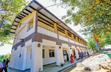 Students await President Sirisena's arrival to open new School building
