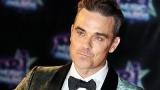 Narrow escapr for Robbie Williams