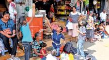 School children playfully await Perahera