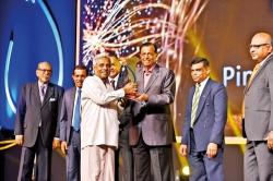 Former minister presents awards