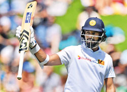 Niroshan, Dimuth and Angelo salvage Lankan pride