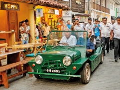PM driven in an old car in an old fort