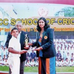 Chamila Heenatigala of NCC, the receives the Best Batsman's award from Madhuri Samuddhika, the special guest