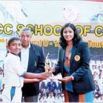 Kithma Sithmal of Sanath Jayasuriya CF receiving the Best Bowler's award from Madhuri Samuddhika while Nelson Mendis, the Director CCC School of Cricket looks on