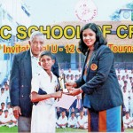 Gimantha Dissanayake of NCC Cricket Academy receiving the Best Fielder's award from Madhuri Samuddhika