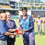 Captain-of-Stafford-International-Shriram-Shyamsunder-receives-the-champions-trophy-from-Arabind-de-Silva