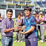 Man-of-the-match-Pravan-Williams-receives-his-trophy-from-Upul-Chandana