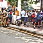 Barricades in place: Schoolboys file past security points