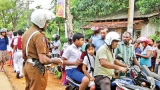 Police take measures to ensure the safety of children who travel to school on motorbikes