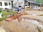 It's muddy hell for  these students  of  Agalawatte  primary school
