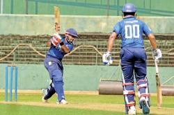 Lakshan's brisk ton  helps Colts sink Navy