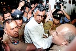 Former megapolis minister surrounded by mega police force