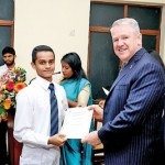 An Award winner receiving his  certificate from the Chief Guest His Excellency David Holly. Australian High Commissioner for Sri Lanka