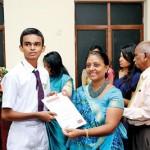 An Award winner receiving his  certificate from the Dean of College of Chemical Sciences Prof. Sagarika Ekanayake