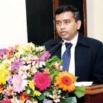 Dr. C.N. Ratnaweera delievering his  presentation.