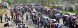 Chaos as thousands crowd transport home for Free Trade Zone workers