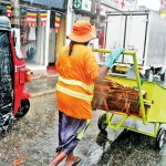 Rain or shine: Municipal workers carry on