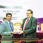 Handing over the Journal  to Mr. Manil Jayesinghe