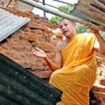 Chief Incumbent Poththukkulame  Dheerananda Thero points out the damage to the structure