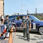 President Gotabaya Rajapaksa drives past  protesters on his way to Presidential Secretariat
